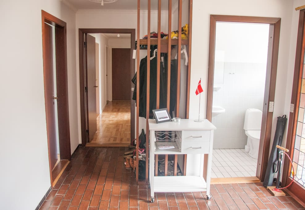 A look at our front foyer area, showing the bedroom corridor and the small bathroom.