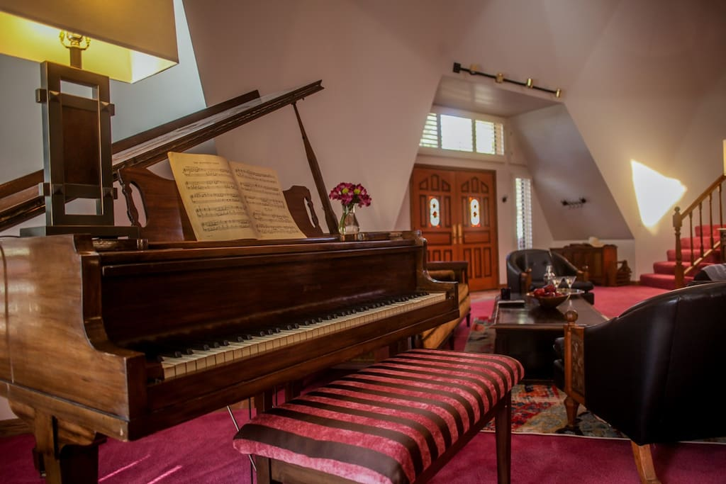 Gigantic great room with plenty of seating and a Baby Grand Piano for the musicians. Entertain with a song or two!
