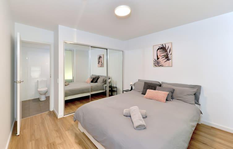 Bedroom 1 - Queen Bed with built in robes