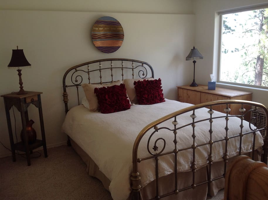 Lower level bedroom with queen bed.