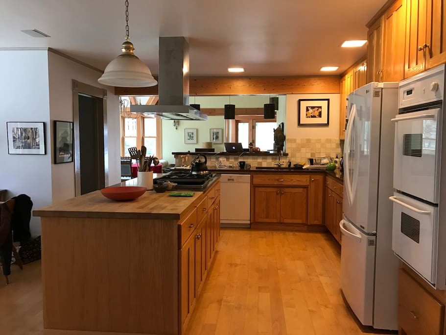 Large kitchen next to great room, dining room, family room