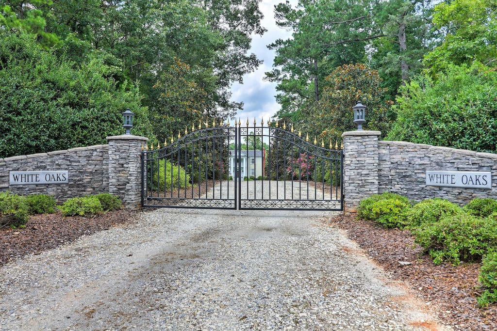 A gated, long driveway lined with over 20 magnolias welcomes you to this amazing estate.