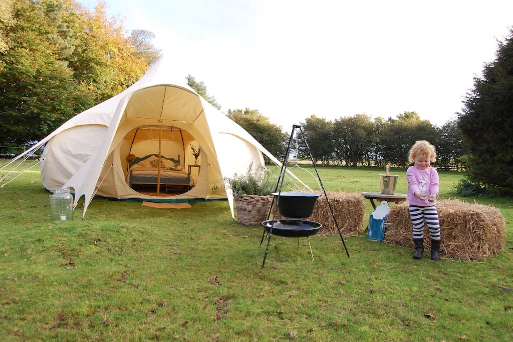 What more do you need, stunning tent, your own field, and a bottle of fizz!