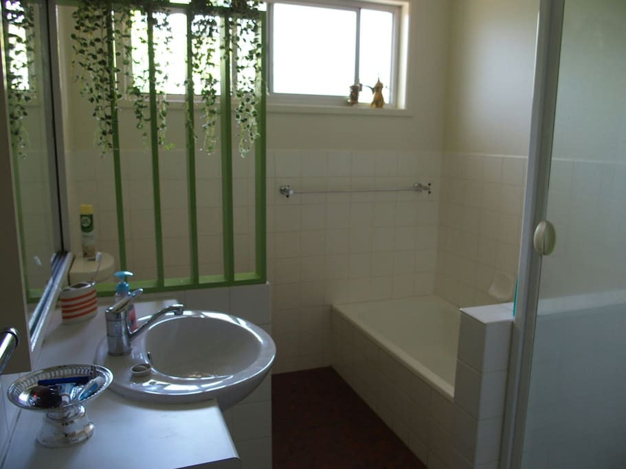 Shared Bathroom with deep Bath and separate Shower