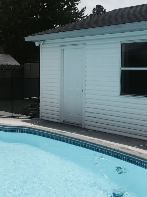 Guest cottage is located next to pool