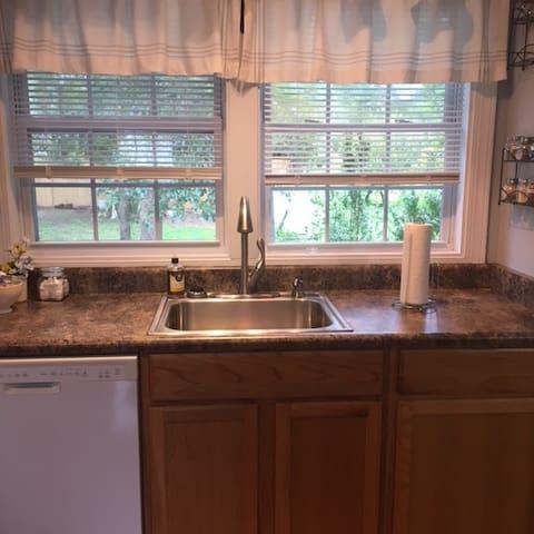The kitchen area overlooks our backyard.