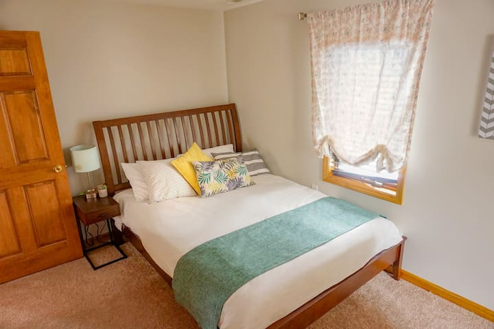 """3rd Bedroom - snug and cozy with a queen bed and 32"""" TV."""