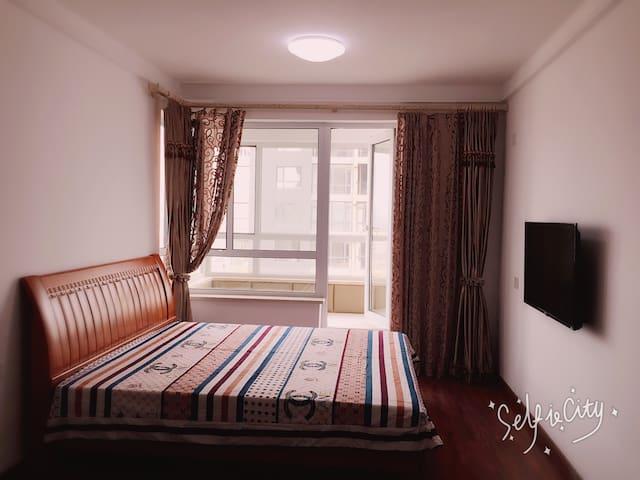 山海广场东边一线海景公寓 - Yingkou - Lägenhet