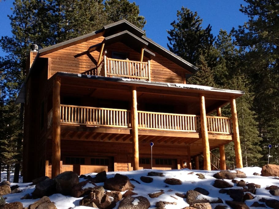 Front view of the cabin in the winter.