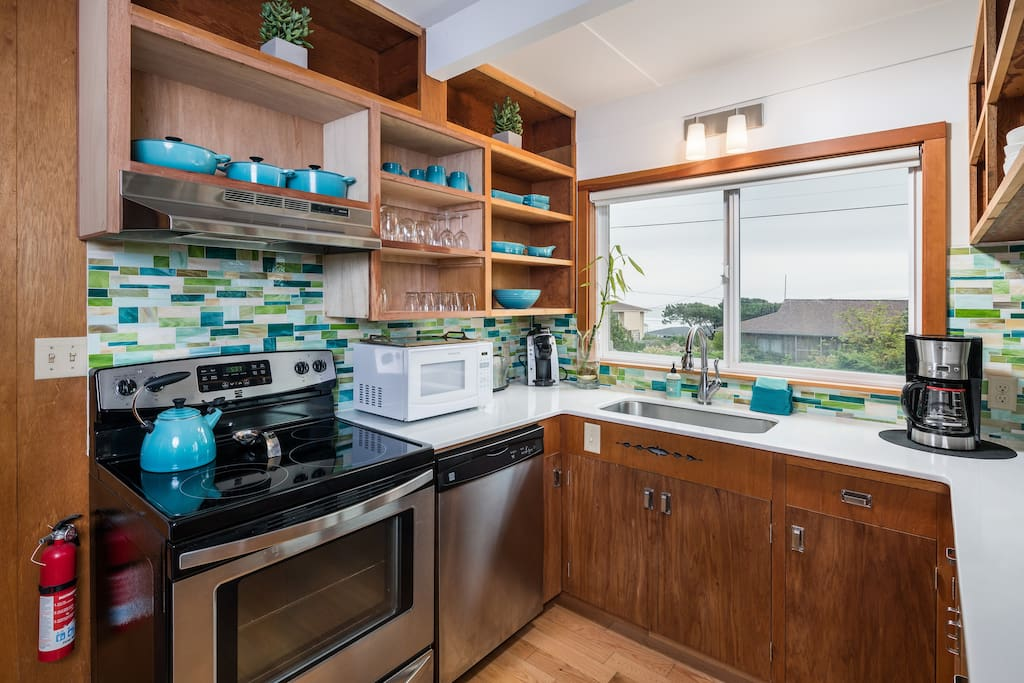 Well-equipped new kitchen features ocean-themed colors and stainless steel appliances