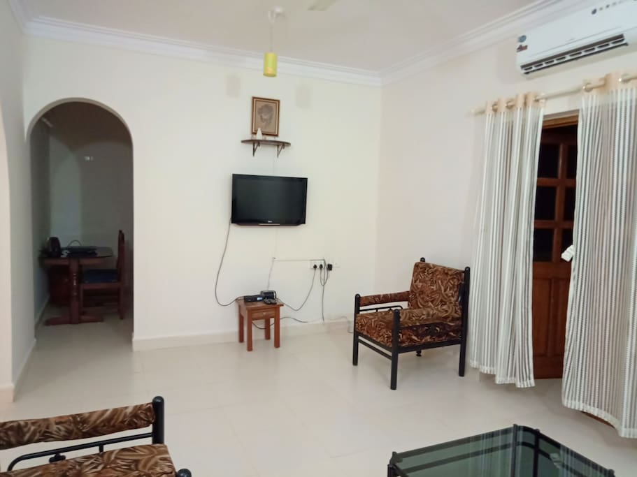 Living room with AC and TV