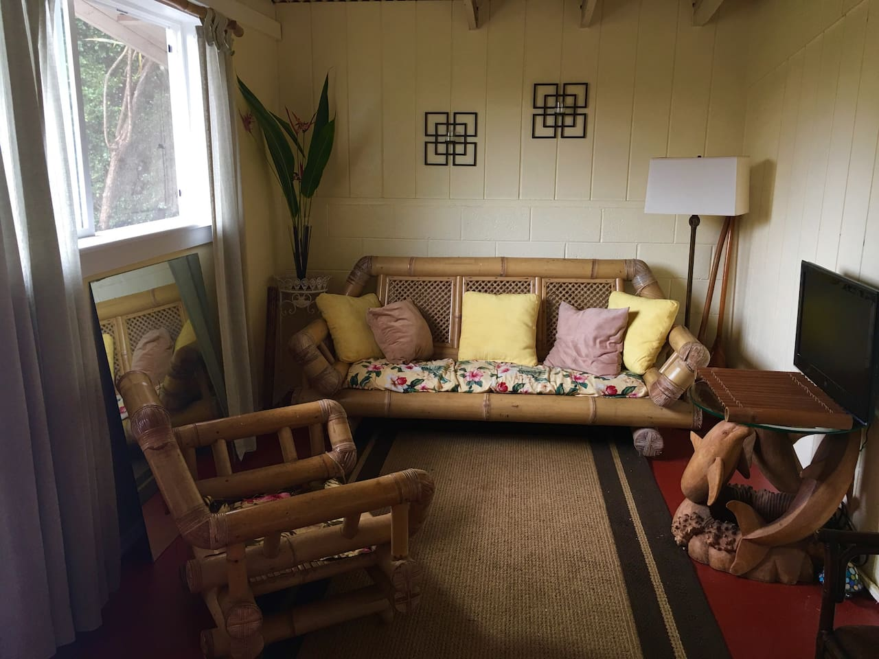 """Private living room space, decorated """"Aloha style""""with bamboo and teak furniture."""