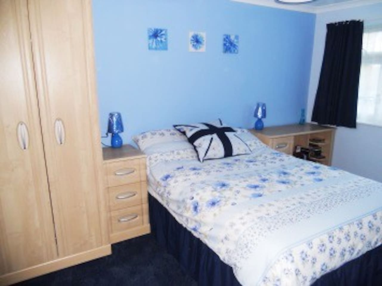 Double bedroom with ample storage and flat screen tv