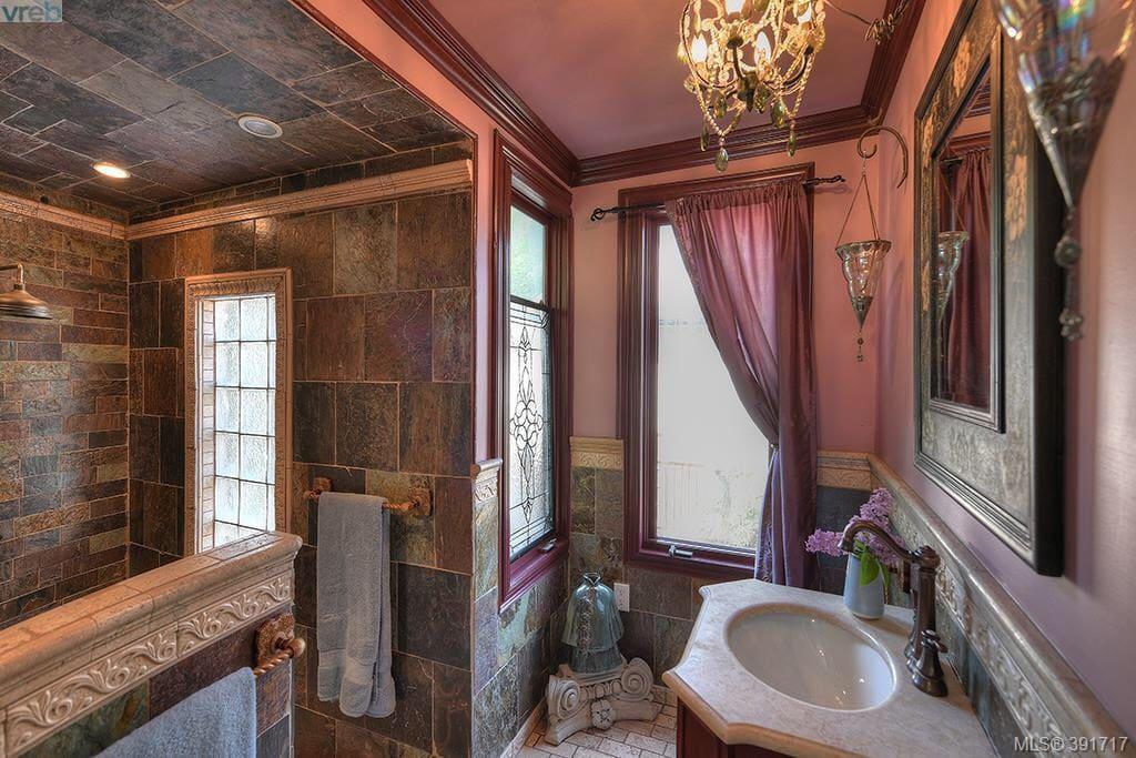 Beautiful slate and marble bathroom with rain head shower and heated floors.