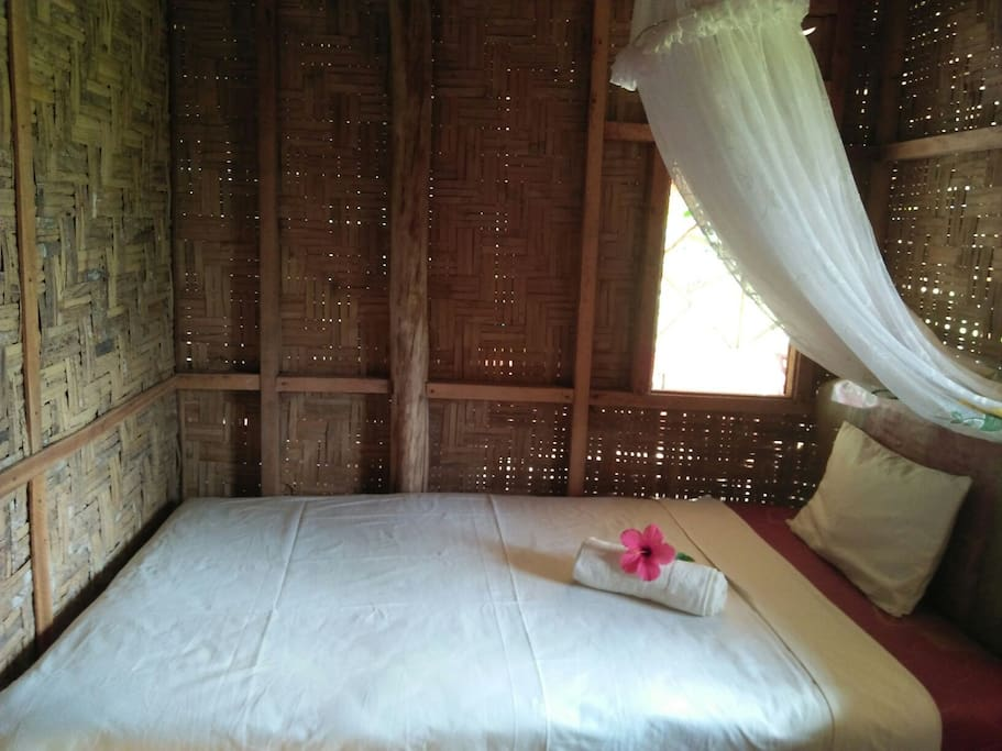 This is the room with traditional wall made of bamboo. There is a great view of the rice field and mountains when you look out the windows.