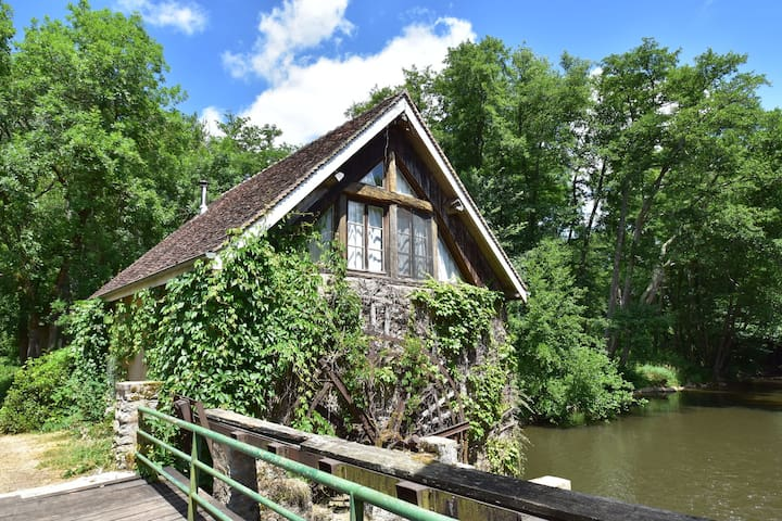 Charming mill is surrounded by water and woods