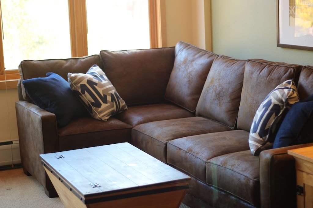 Brand new sectional with queen sleeper and new gel-mattress.