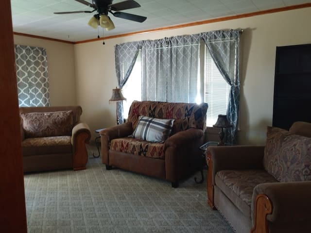 Spacious living room with twin hide a bed. Also the 2 over sized chairs can be out together for the perfect toddler bed.  TV with DVD player, satellite, and internet.