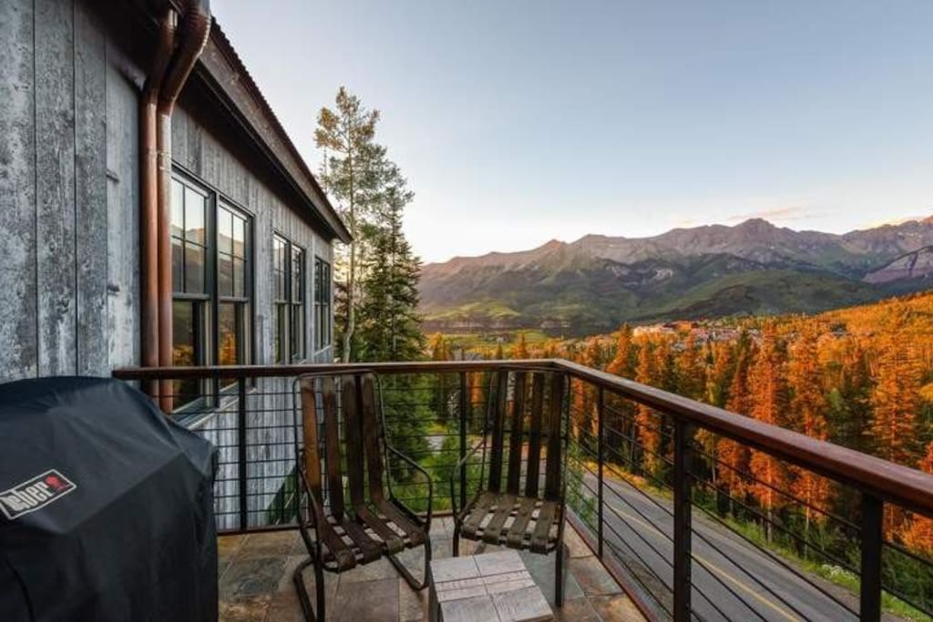 The side patio with your private gas grill overlooks the treetops and distant peaks.