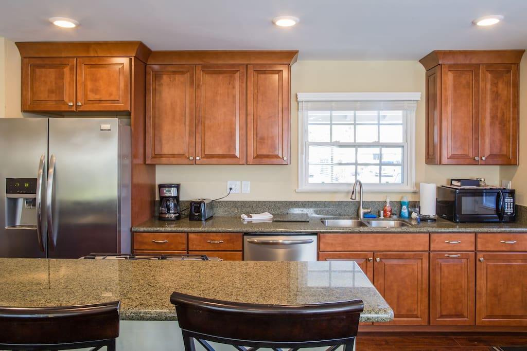 Fully equipped kitchen with granite counter tops, microwave, coffeemaker, toaster and all the dinnerware and utensils you need