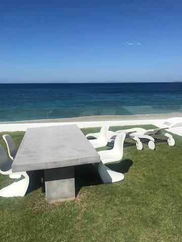 Outside dinner table & sun beds
