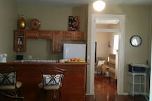 kitchen with island and 2 barstools