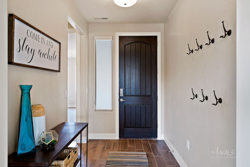 Welcome! Come in and Stay Awhile. Entry Way with hooks.