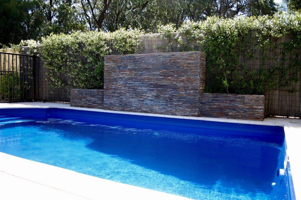 Pool with stone water feature