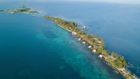 Private Overwater Bungalow at Thatch Caye Private Island
