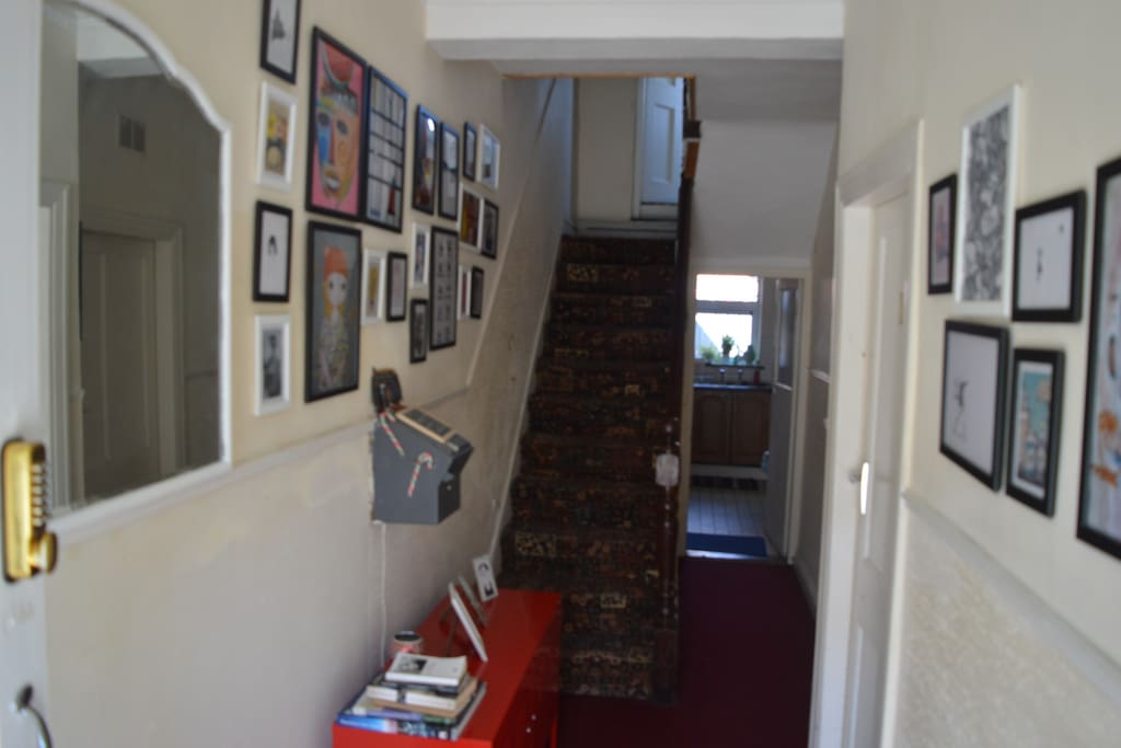 Quirky entrance hallway to house has funky art work thoughout