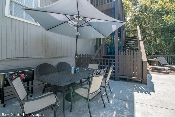 Large table with 6 chairs, large umbrella for full shaded area and rolling cooler with bottle opener attached.
