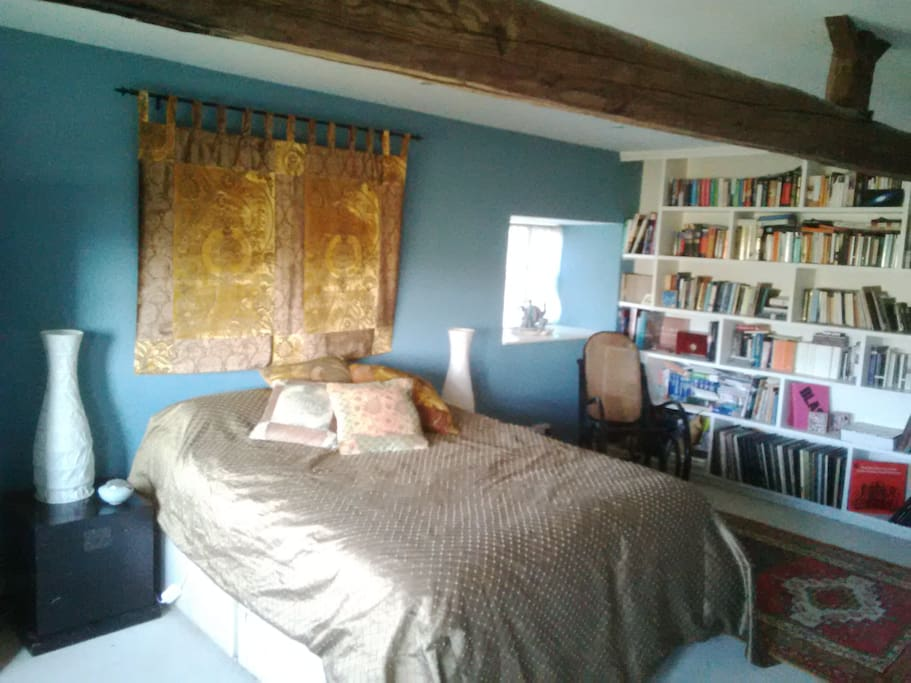 The main bedroom with plenty of reading matter...