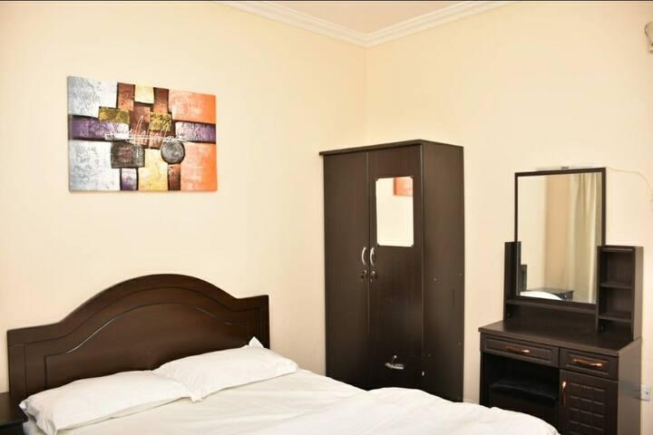 Room with bathroom, balcony in Naif 2