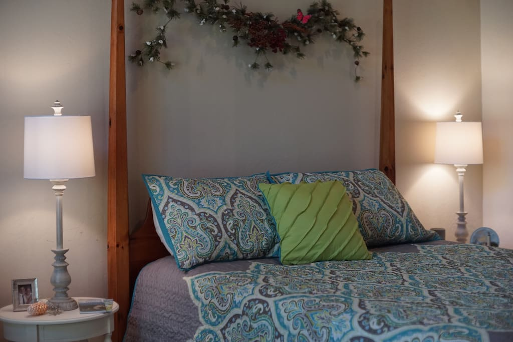 The Retreat Room features a comfortably decorated Queen bed, aka Maximum Relaxation