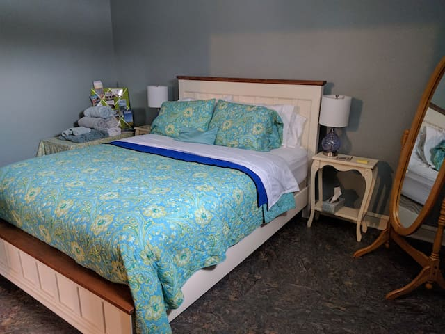Comfy Bed with all amenities including slippers