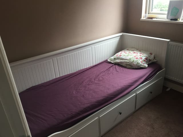 A clean single bed