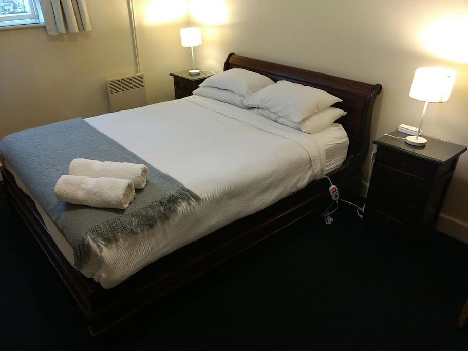 Master bedroom with a beautiful Queen sleigh bed with quality electric blanket