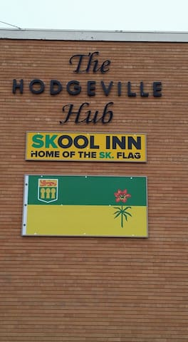 Signs on the front of our Skool Inn