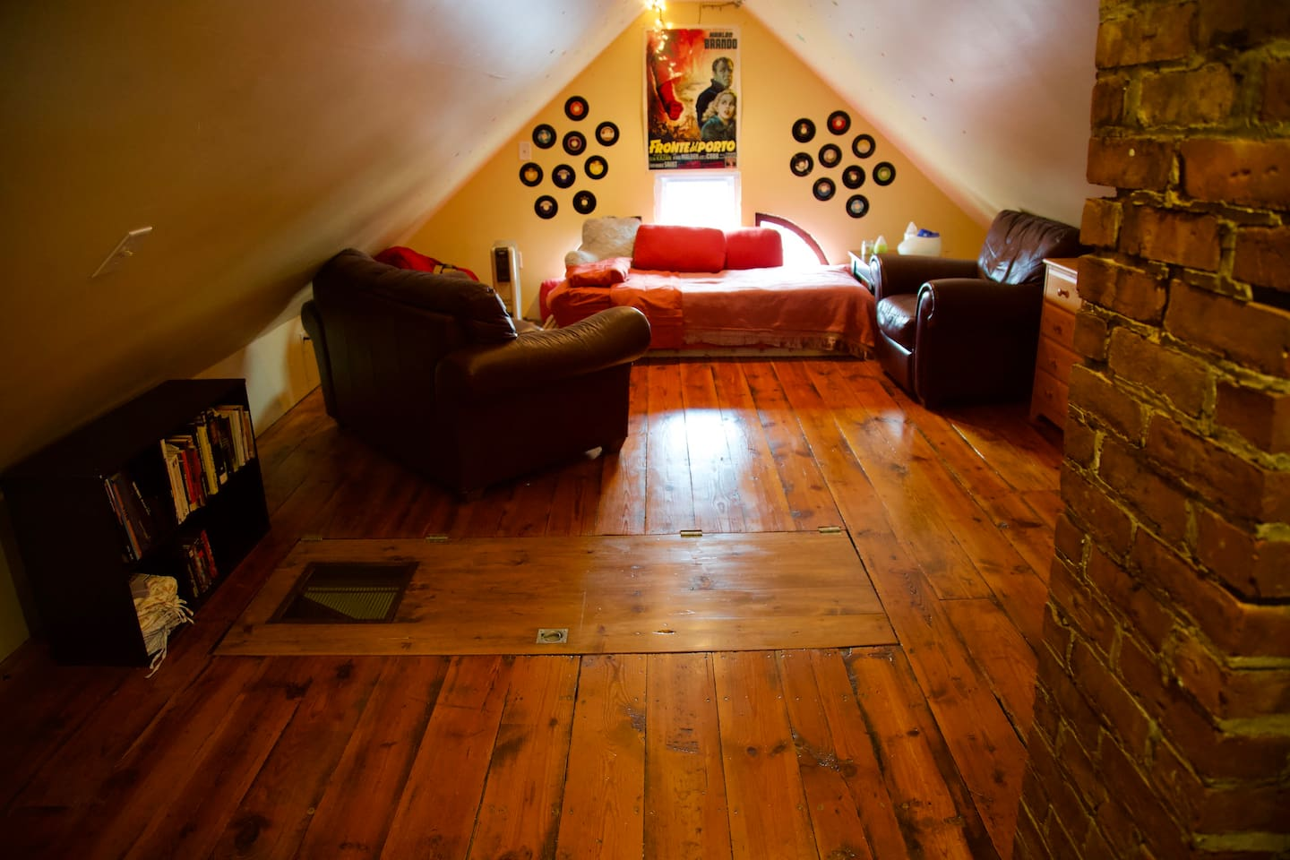 Cozy bright, clean space and view of the trap door entry way folded down for easeful living and walking about.