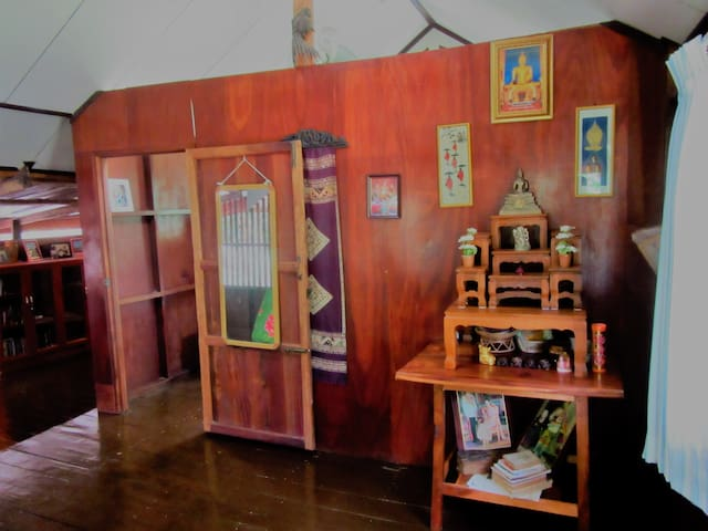 The entrance room to the Lost Bungalo.  There are many pictures from our travels, Silk and other handicrafts, and most importantly a Buddha Shrine to secure good luck and protection for your stay.