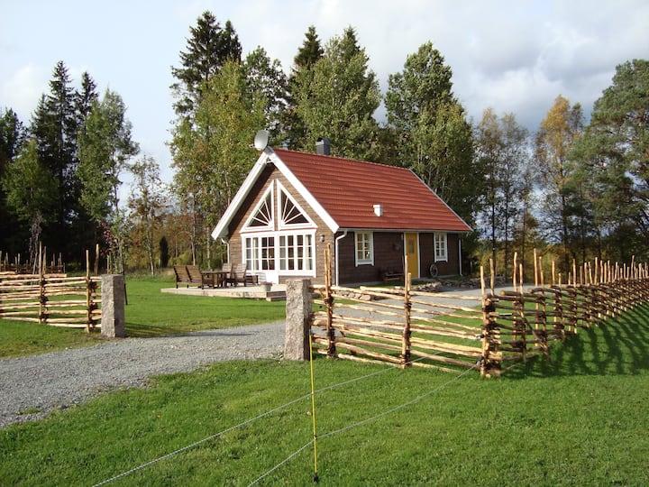 Stuga, timmerhus  i skogsgläntan Småland Sweden