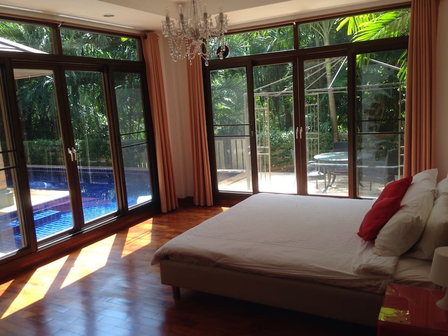 Master bedroom. Just step out , and take a dip anytime. Surrounded by trees all around gives you privacy and in tune with nature.