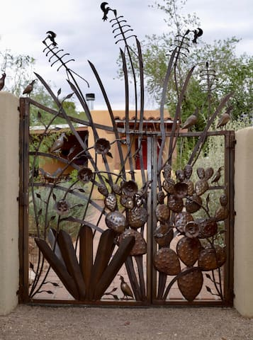 Enter the courtyard and guesthouse through this sculptural metal gate built by a local artist.