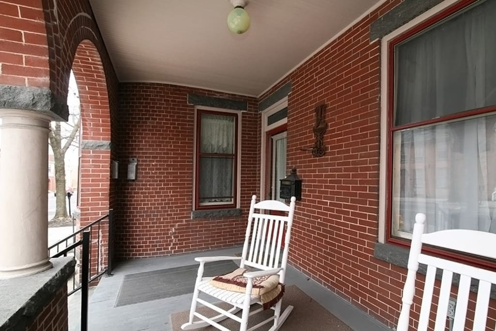Beautiful deep front porch perfect for people watching or parade viewing.