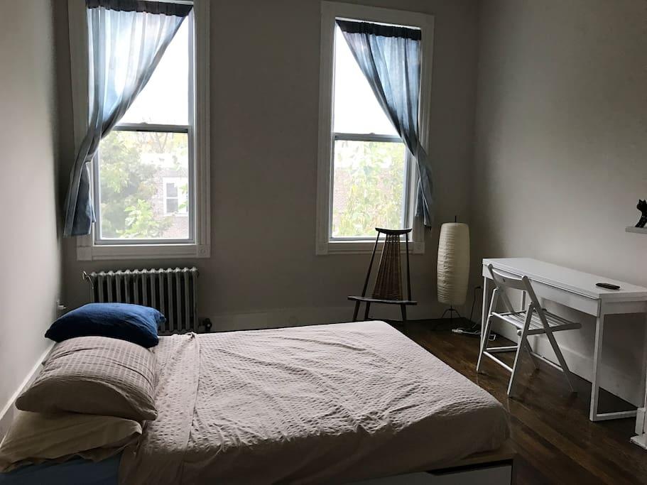 Bedroom is on second floor, faces toward the backyard