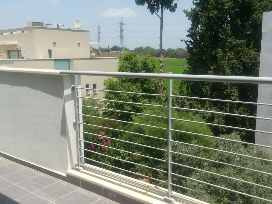 view from a balcony on the third floor to the fields. Mult light