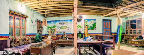 Big dining room, house built with traditional way, home stay