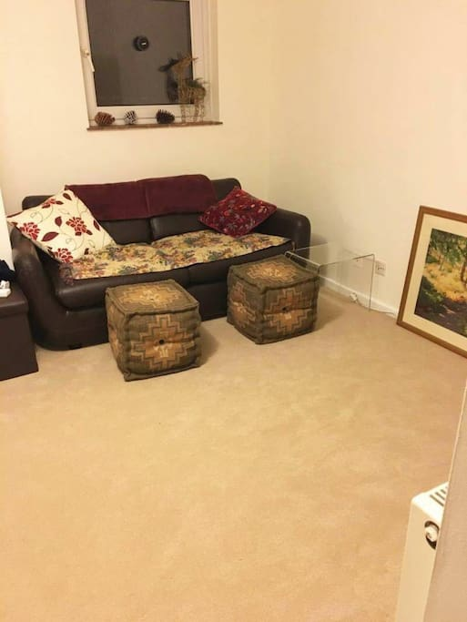 Cosy living room with large TV opposite sofa