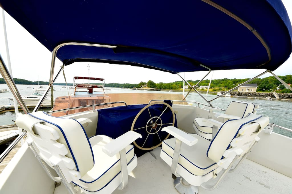 Enjoy the life on the Damariscotta River from the upper helm.