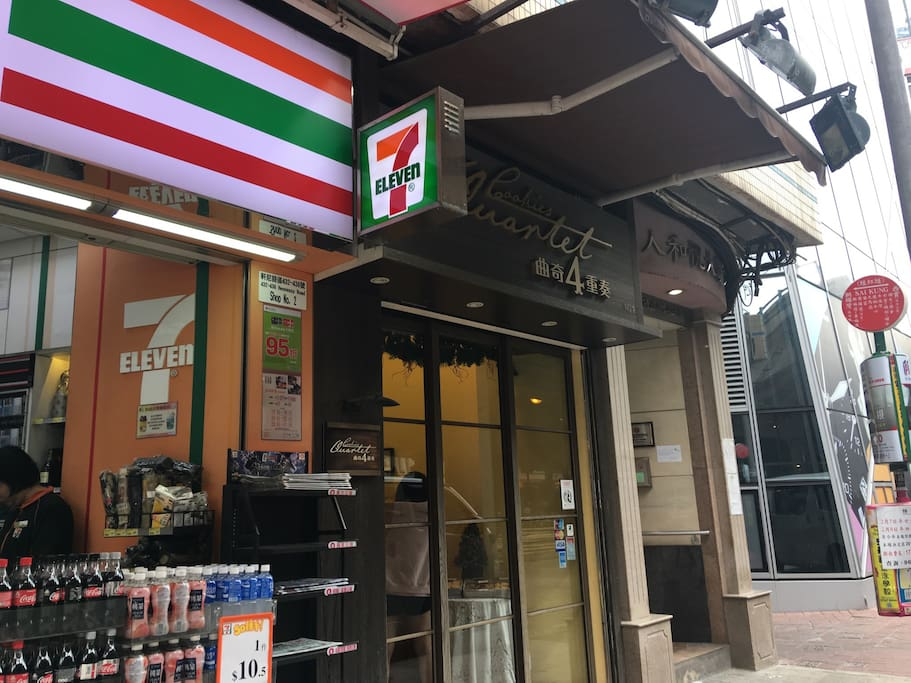 main entrance with 7-11 convenience store right down the stairs